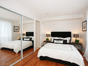 10 Interior Design Ideas Make Your Small Bedroom Look Bigger on a Budget Add wall mirror